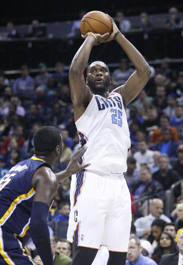 Charlotte Bobcats center Al Jefferson, right, shoots over Indiana Pacers center Roy Hibbert during the first half of an NBA basketball game in Charlotte, N.C., Wednesday, March 5, 2014