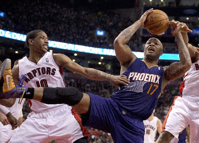 Toronto Raptors guard DeMar DeRozan (10) and Phoenix Suns guard P.J.Tucker (17) battle for a rebound during the first half of an NBA basketball game in Toronto on Sunday, March 16, 2014