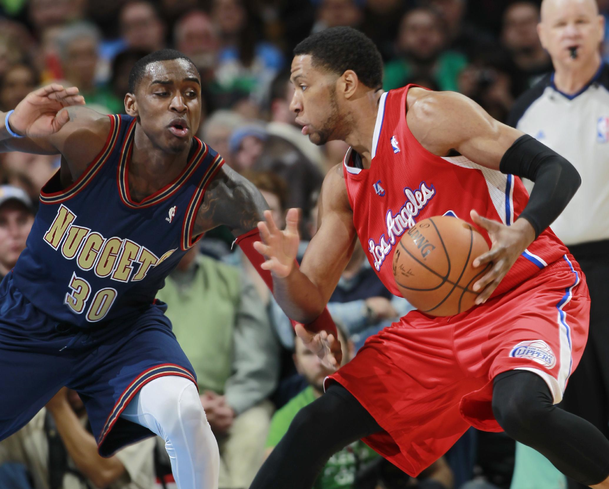 Los Angeles Clippers forward Danny Granger, right, works ball inside as Denver Nuggets forward Quincy Miller covers in the fourth quarter of the Nuggets' 110-100 victory in an NBA basketball game in Denver on Monday, March 17, 2014