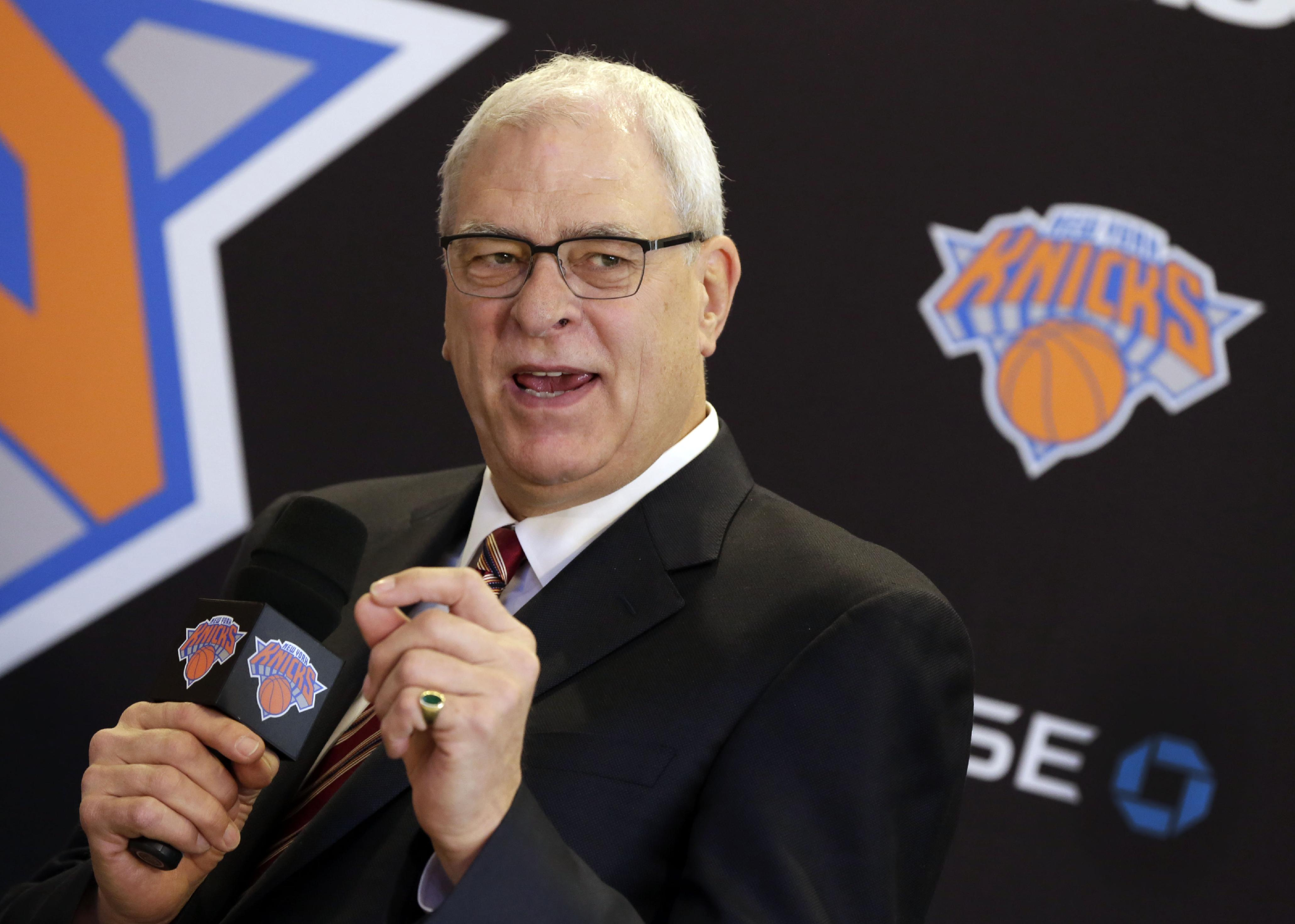 New York Knicks new team president Phil Jackson responds to a question during a news conference where he was introduced, at New York's Madison Square Garden, Tuesday, March 18, 2014. Jackson signed a five-year contract that will reportedly pay him at least $12 million annually and said he will spend significant time in New York