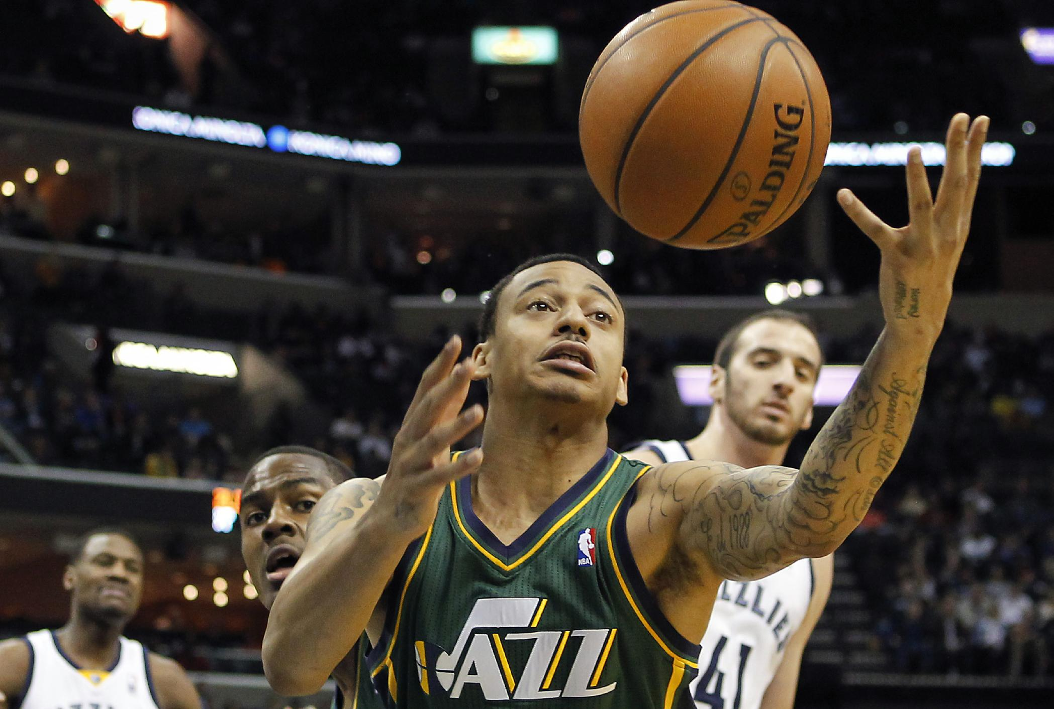Utah Jazz guard Diante Garrett (8) tries to grab a rebound against the Memphis Grizzlies in the first half of an NBA basketball game on Wednesday, March 19, 2014, in Memphis, Tenn