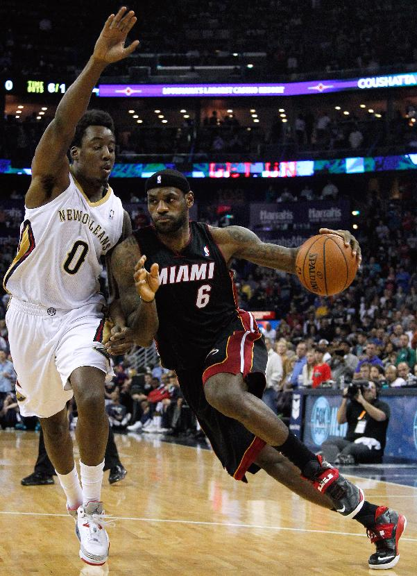 Miami Heat forward LeBron James (6) drives against New Orleans Pelicans forward Al-Farouq Aminu (0) during the first half of an NBA basketball game in New Orleans, Saturday, March 22, 2014