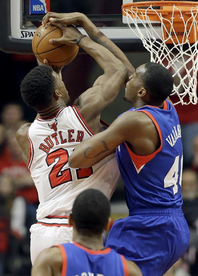 Philadelphia 76ers forward Jarvis Varnado (40), right, blocks a shot by Chicago Bulls guard Jimmy Butler (21) during the first half of an NBA basketball game in Chicago on Saturday, March 22, 2014