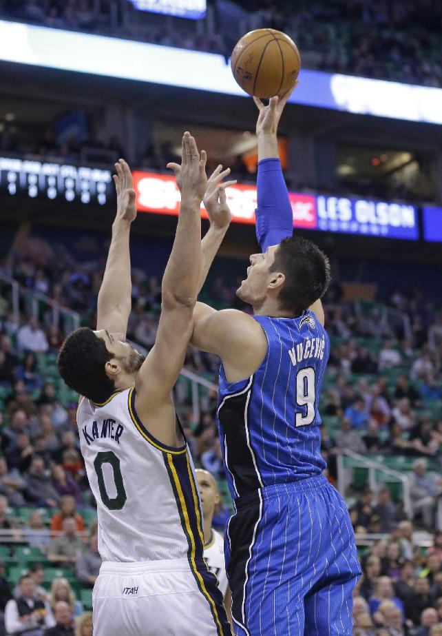 Orlando Magic's Nikola Vucevic (9), of Montenegro, shoots as Utah Jazz's Enes Kanter (0), of Turkey, defends in the first quarter during an NBA basketball game on Saturday, March 22, 2014, in Salt Lake City