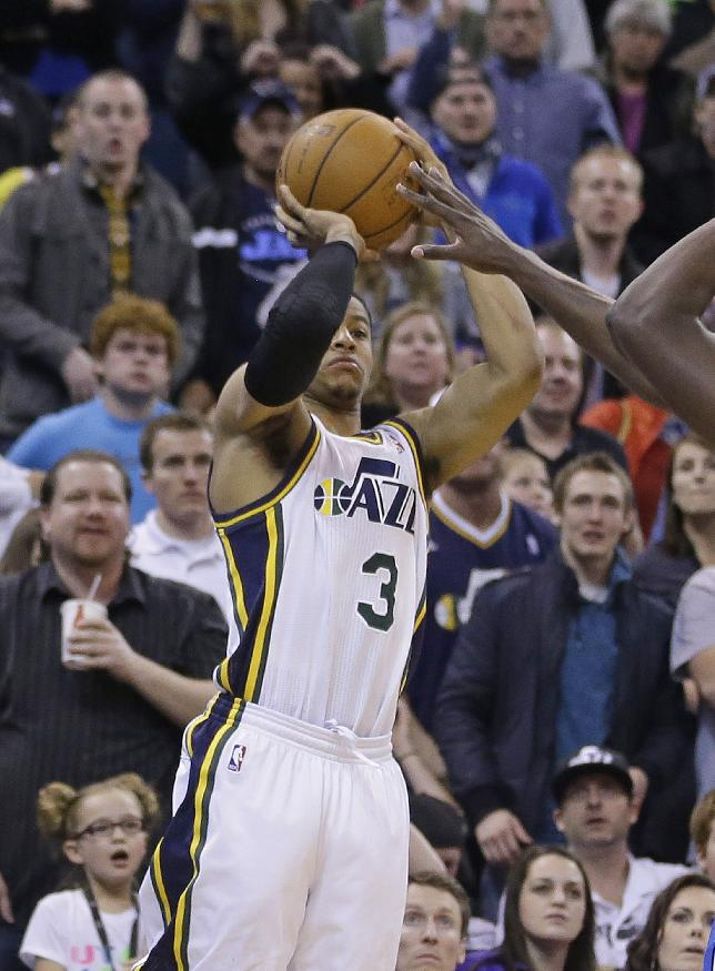 Utah Jazz's Trey Burke (3) shoots the game-winning 3-pointer against the Orlando Magic in the fourth quarter during an NBA basketball game Saturday, March 22, 2014, in Salt Lake City. The Jazz won 89-88