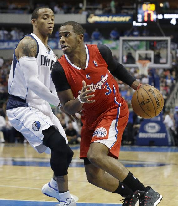 Los Angeles Clippers guard Chris Paul (3) drives past Dallas Mavericks guard Monta Ellis during the first half of an NBA basketball game Thursday, March 27, 2014, in Dallas. The Clippers won 109-103