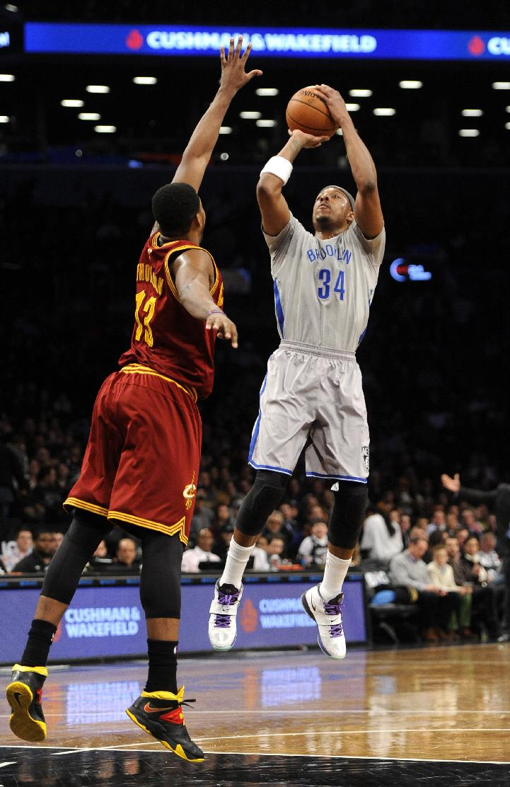 Brooklyn Nets' Paul Pierce (34) shoots over Cleveland Cavaliers' Tristan Thompson (13) in the first half of an NBA basketball game Friday, March 28, 2014, in New York