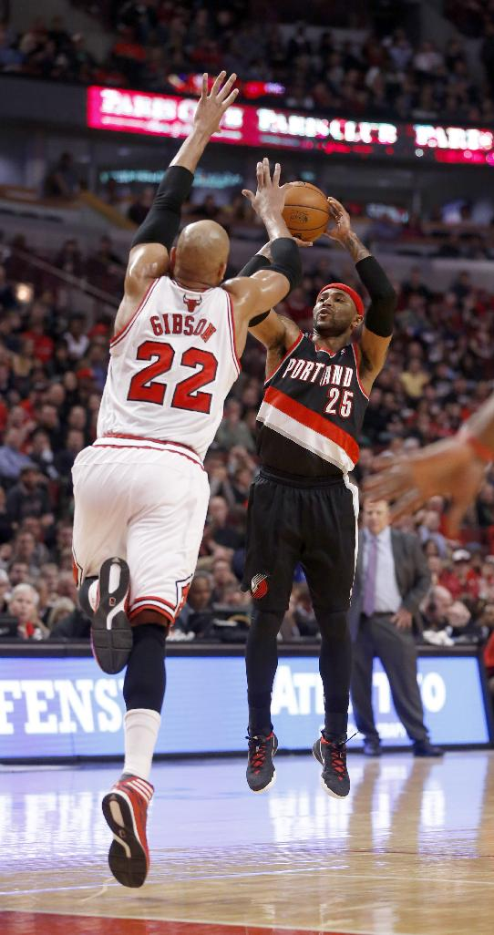 Portland Trail Blazers guard Mo Williams (25) shoots as Chicago Bulls forward Taj Gibson (22) defends during the first half of an NBA basketball game Friday, March 28, 2014, in Chicago