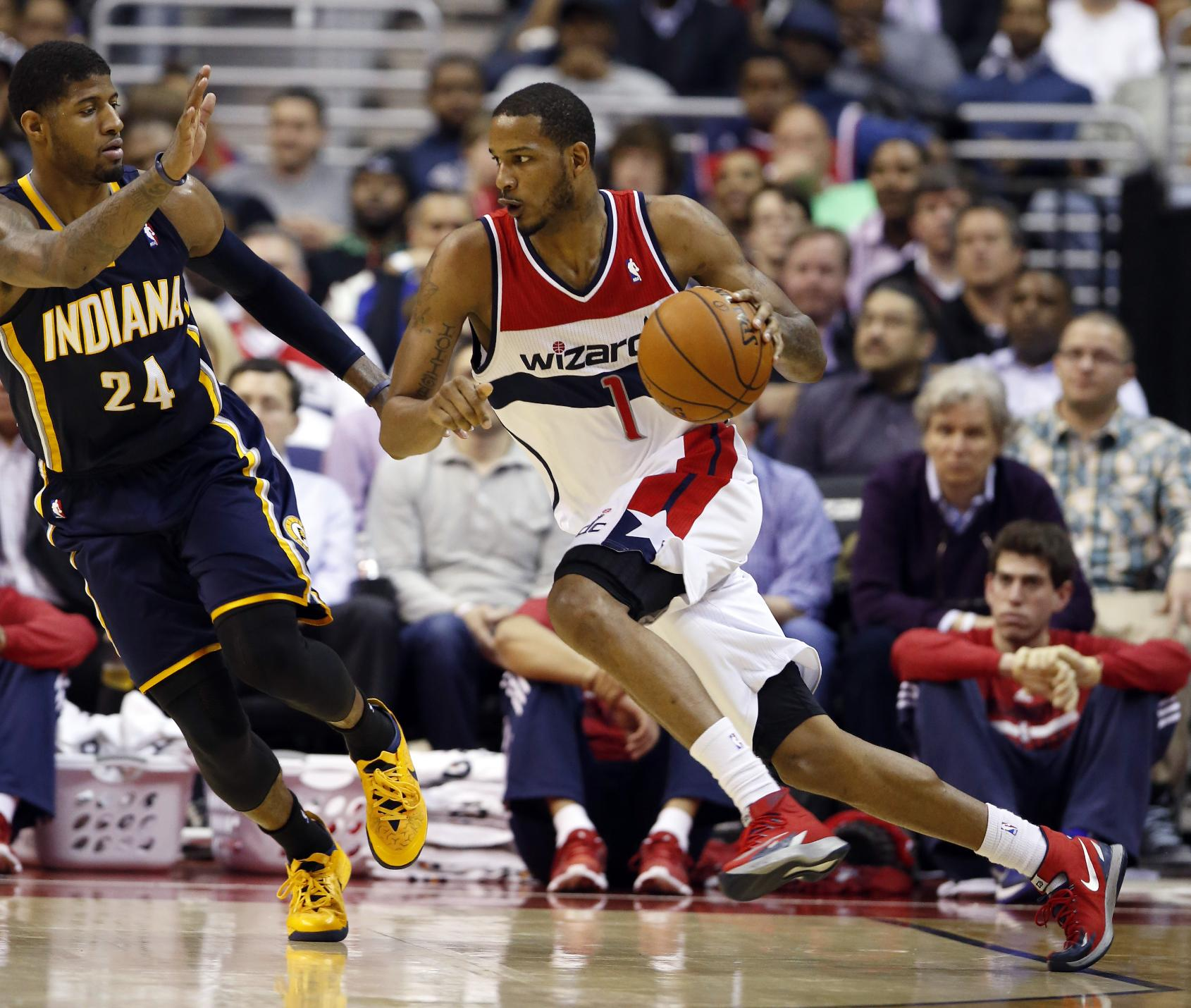 Washington Wizards forward Trevor Ariza (1) drives against Indiana Pacers forward Paul George (24) in the second half of an NBA basketball game on Friday, March 28, 2014, in Washington. The Wizards won 91-78