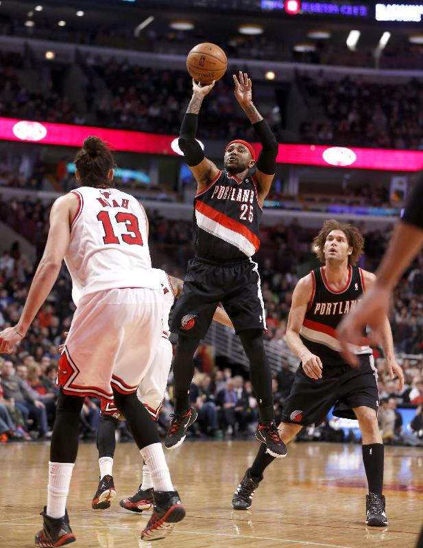 Portland Trail Blazers guard Mo Williams (25) shoots over Chicago Bulls center Joakim Noah (13) as Robin Lopez watches during the second half of an NBA basketball game Friday, March 28, 2014, in Chicago. The Trail Blazers won 91-74