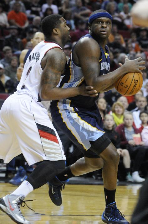Memphis Grizzlies' Zach Randolph (50) looks to pass against Portland Trail Blazers' Wesley Matthews (2) during the first half of an NBA basketball game in Portland, Ore., Sunday March 30, 2014