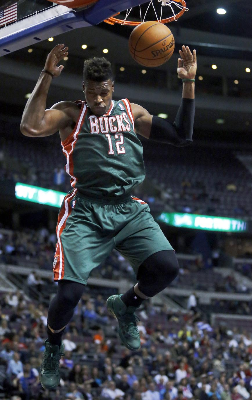 Milwaukee Bucks forward Jeff Adrien (12) dunks the ball against the Detroit Pistons during the first half of an NBA basketball game Monday, March 31, 2014, in Auburn Hills, Mich