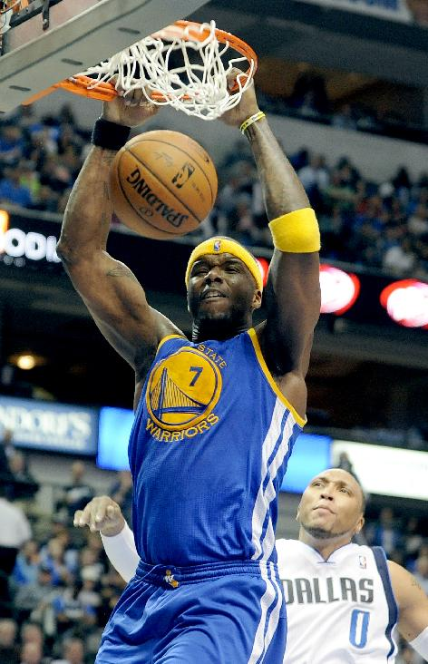 Golden State Warriors center Jermaine O'Neal (7) dunks past Dallas Mavericks forward Shawn Marion (0) in the second half of an NBA basketball game, Tuesday, April 1, 2014, in Dallas. Golden State won 122-120 in overtime
