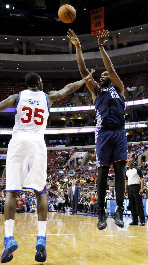 Charlotte Bobcats' Al Jefferson (25) goes up for a shot against Philadelphia 76ers' Henry Sims (35) during the first half of an NBA basketball game, Wednesday, April 2, 2014, in Philadelphia