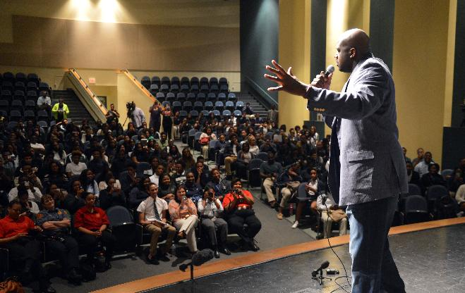 Retired NBA basketball player Shaquille O'Neal speaks during an educational program highlighting the impact of dangerous driving practices and distracted driving on Thursday, April 3, 2014, in Lithonia, Ga