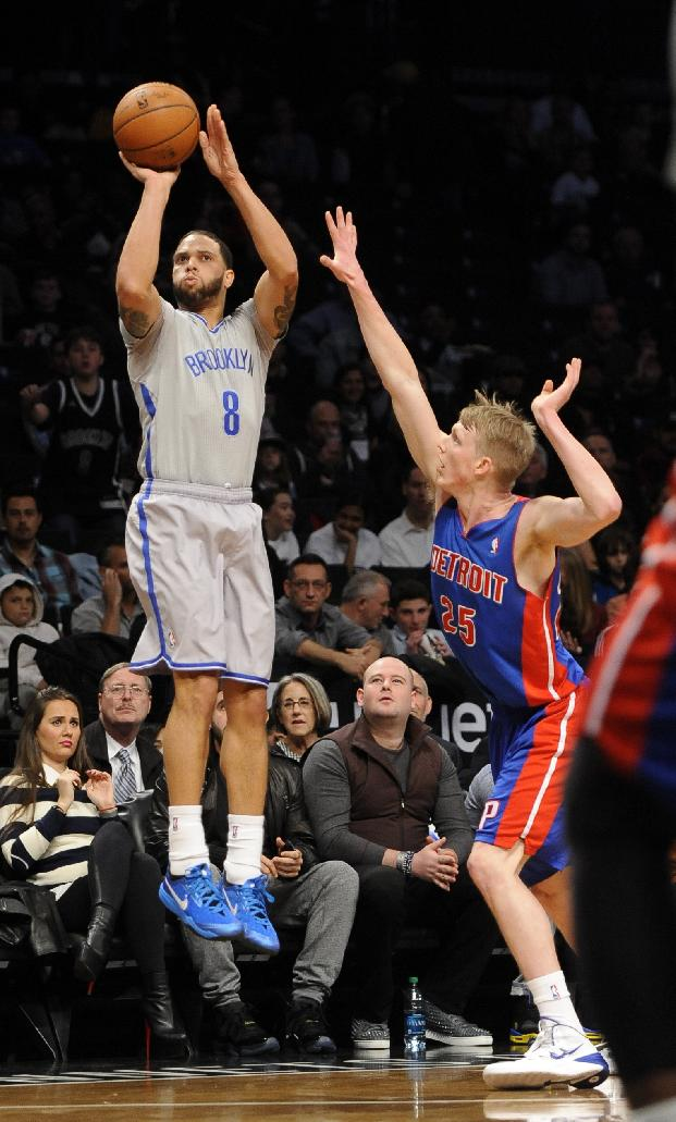 Brooklyn Nets' Deron Williams (8) take aim over Detroit Pistons' Kyle Singler (25) in the first half of an NBA basketball game on Friday, April 4, 2014, in New York