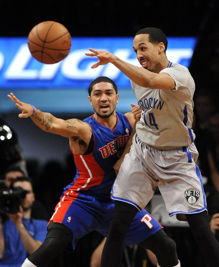 Brooklyn Nets' Shaun Livingston (14) passes around Detroit Pistons' Peyton Siva in the second half of an NBA basketball game on Friday, April 4, 2014, in New York. The Nets won 116-104