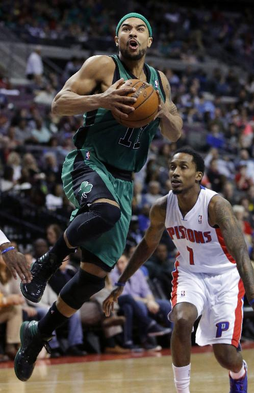 Boston Celtics guard Jerryd Bayless (11) goes to the basket past Detroit Pistons guard Brandon Jennings (7) during the second half of an NBA basketball game Saturday, April 5, 2014, in Auburn Hills, Mich. Bayless led the Celtics with 25 points. The Pistons won 115-111
