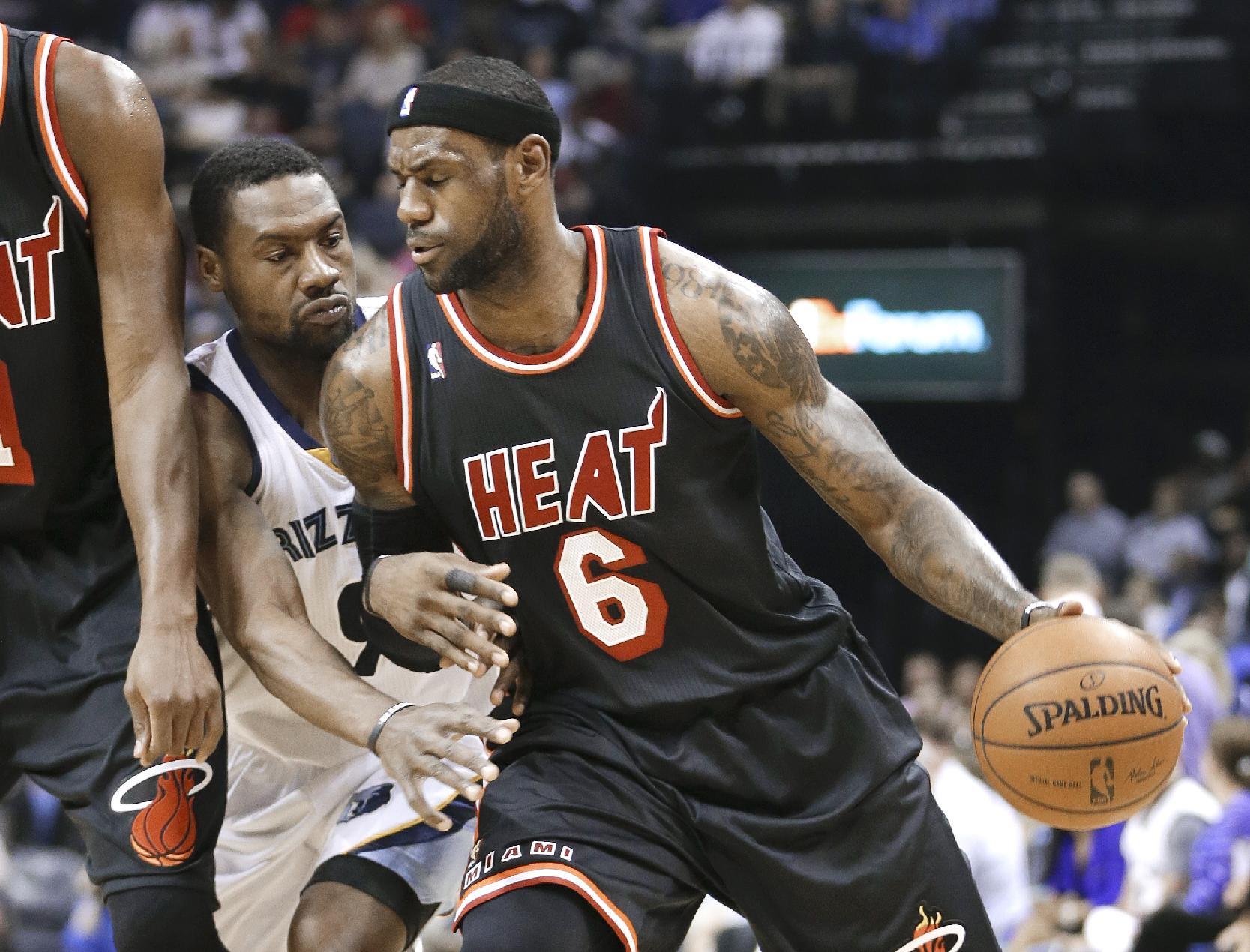 Miami Heat forward LeBron James (6) drives around Memphis Grizzlies guard Tony Allen (9) in the first half of an NBA basketball game Wednesday, April 9, 2014, in Memphis, Tenn
