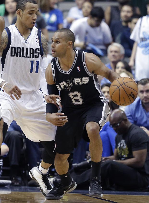 San Antonio Spurs guard Patty Mills (8) dribbles against Dallas Mavericks guard Monta Ellis (11) during the second half an NBA basketball game Thursday, April 10, 2014, in Dallas. The Spurs won 109-100