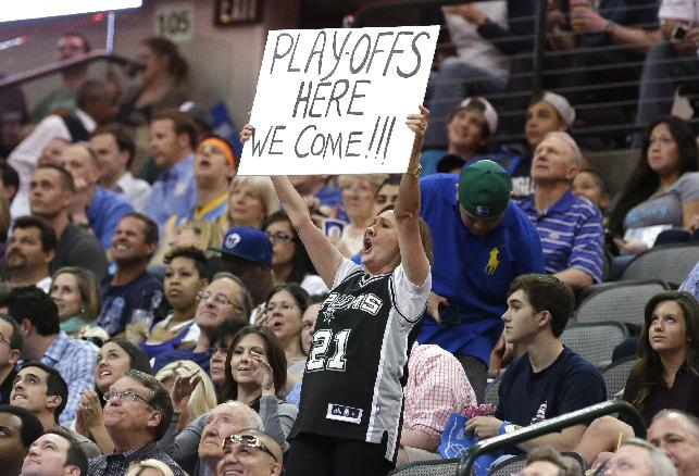 A lone San Antonio Spurs fan holds up a sign during the second half the Spurs' NBA basketball game against the Dallas Mavericks on Thursday, April 10, 2014, in Dallas. The Spurs won 109-100