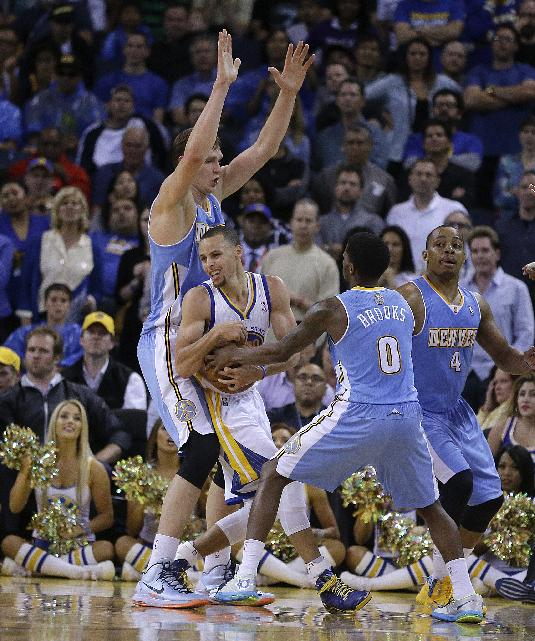 Golden State Warriors' Stephen Curry is guarded by Denver Nuggets' Aaron Brooks (0), Randy Foye (4) and Timofey Mozgov during the second half of an NBA basketball game Thursday, April 10, 2014, in Oakland, Calif