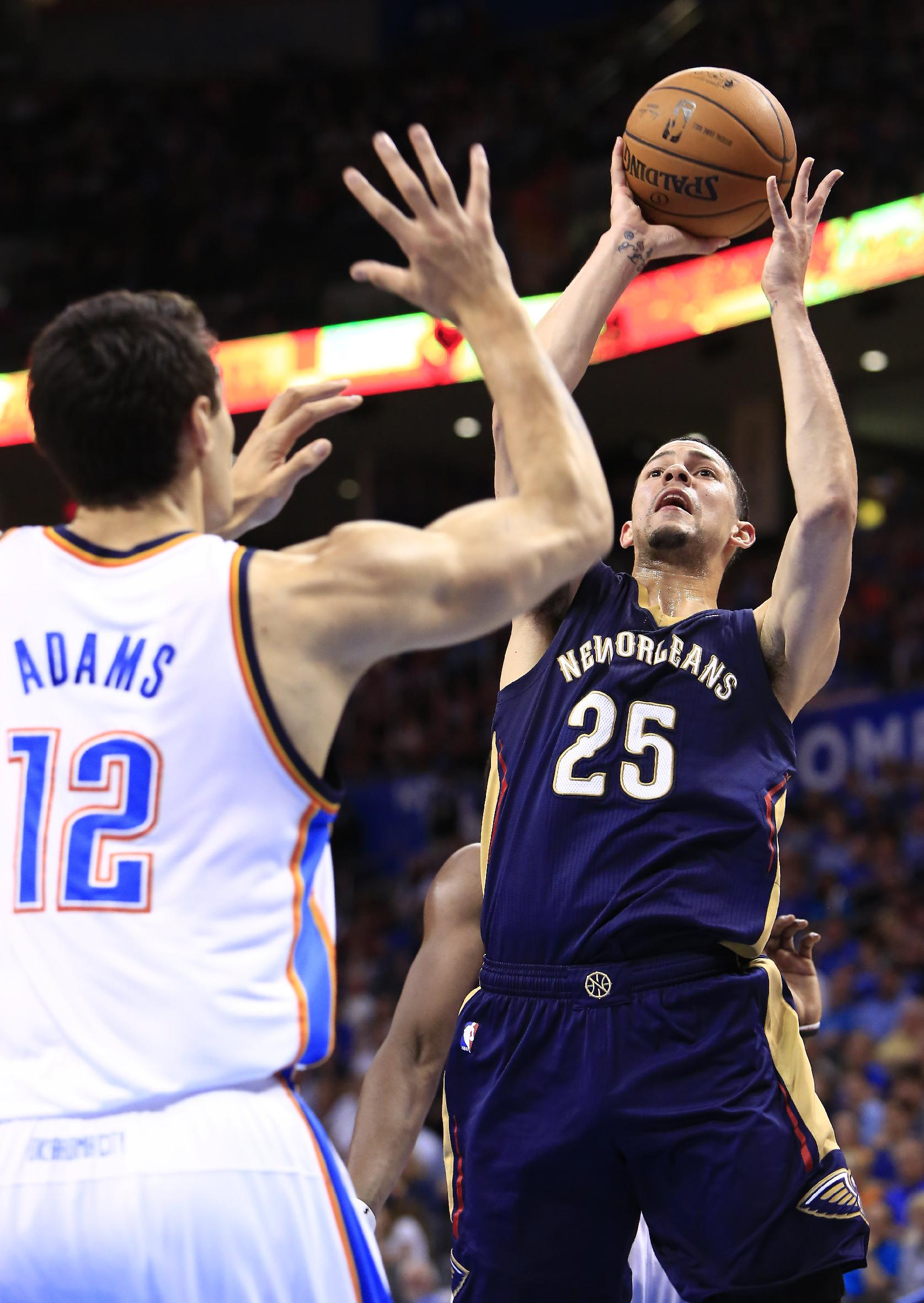 New Orleans Pelicans guard Austin Rivers (25) shoots as Oklahoma City Thunder center Steven Adams (12) defends during the fourth quarter of a NBA basketball game in Oklahoma City, Friday, April 11, 2014. Oklahoma City won 116-94