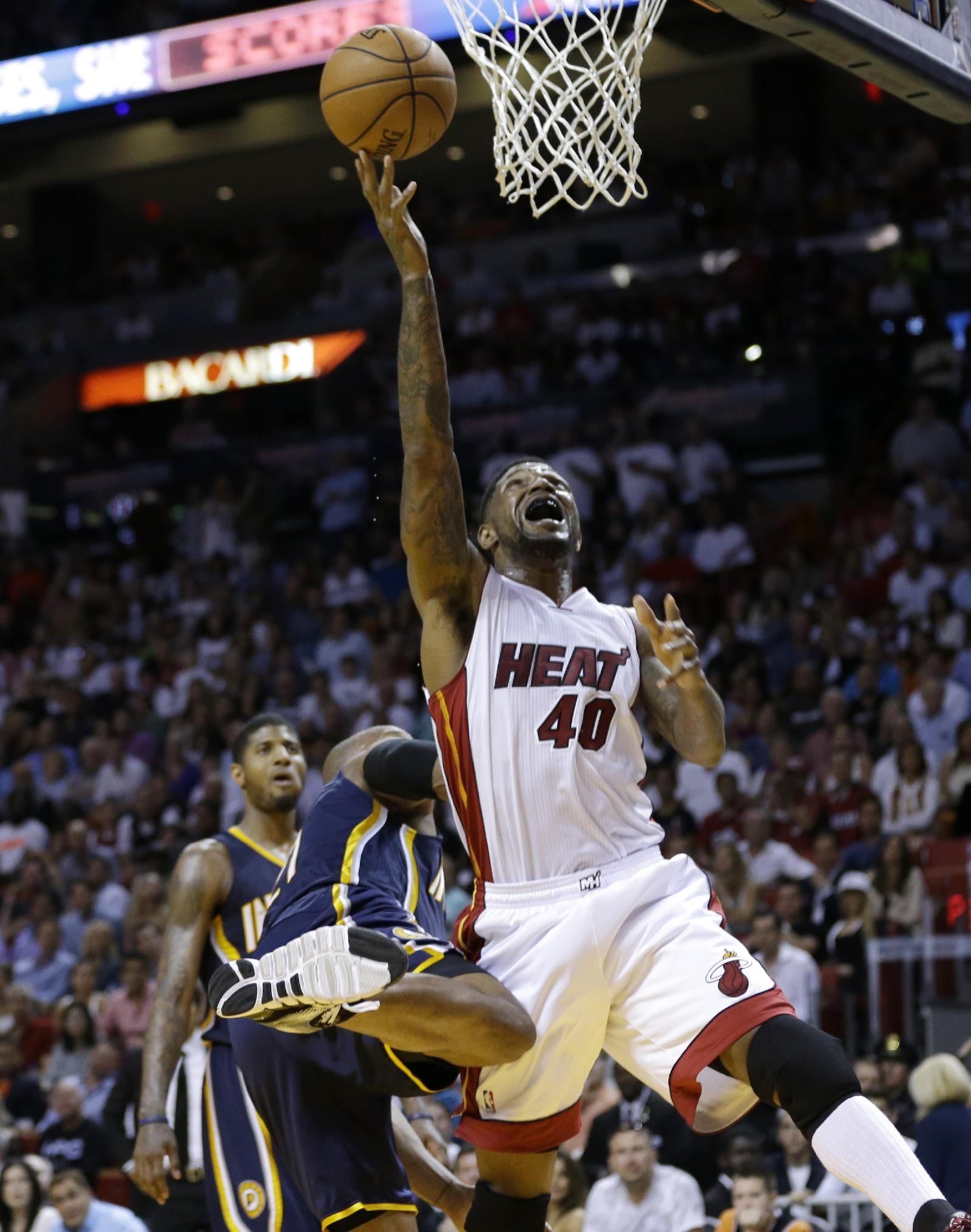 Miami Heat's Udonis Haslem (40) shoots during the second half of an NBA basketball game against the Indiana Pacers, Friday, April 11, 2014, in Miami. The Heat defeated the Pacers 98-86