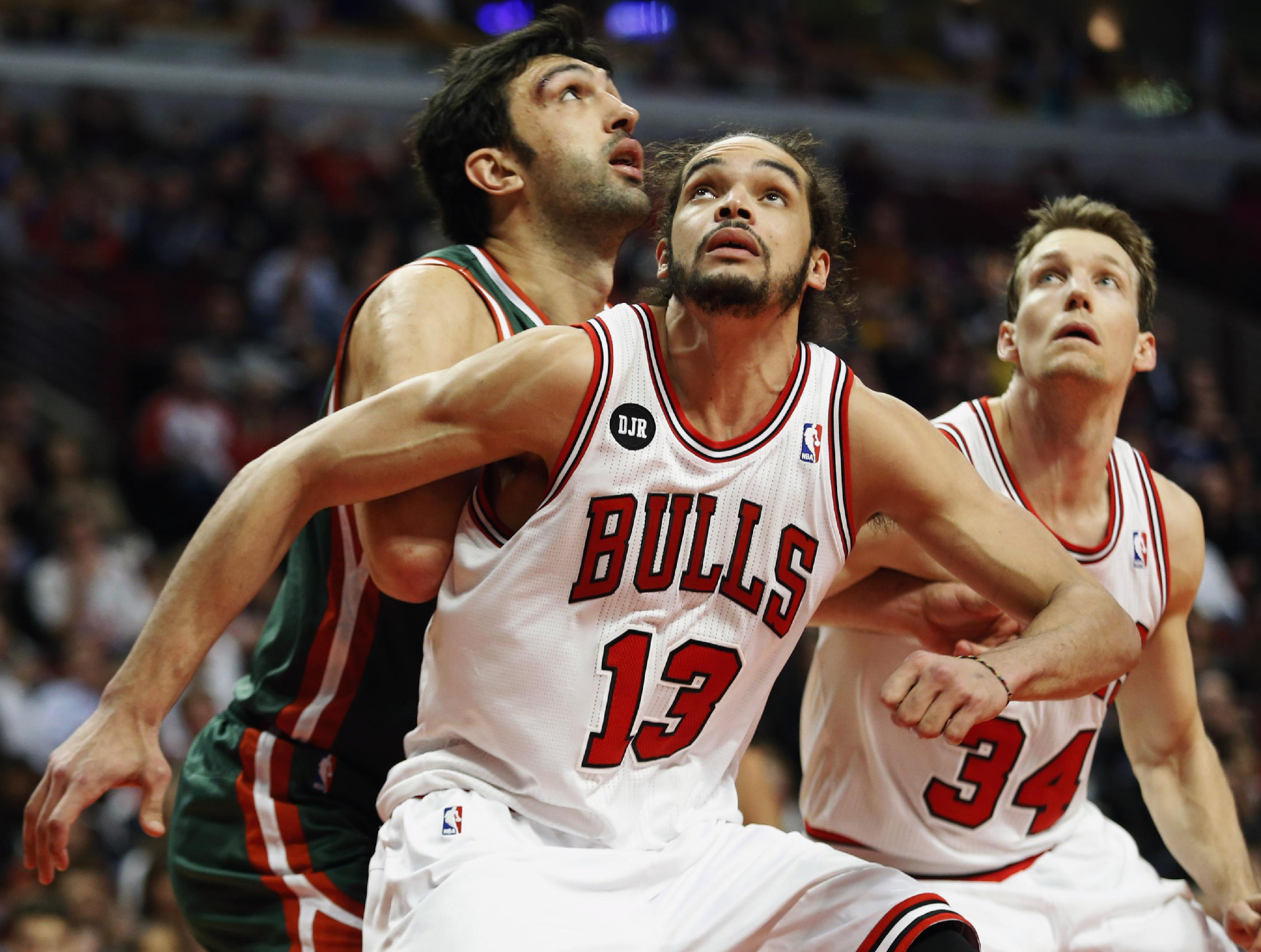 In this April 4, 2014 file photo, Chicago Bulls center Joakim Noah (13) defends against Milwaukee Bucks center Zaza Pachulia during an NBA basketball game in Chicago.  A person familiar with the situation says that Noah is the NBA's Defensive Player of the Year. The person spoke Monday, April 21, 2014 on the condition of anonymity because the award had not been announced