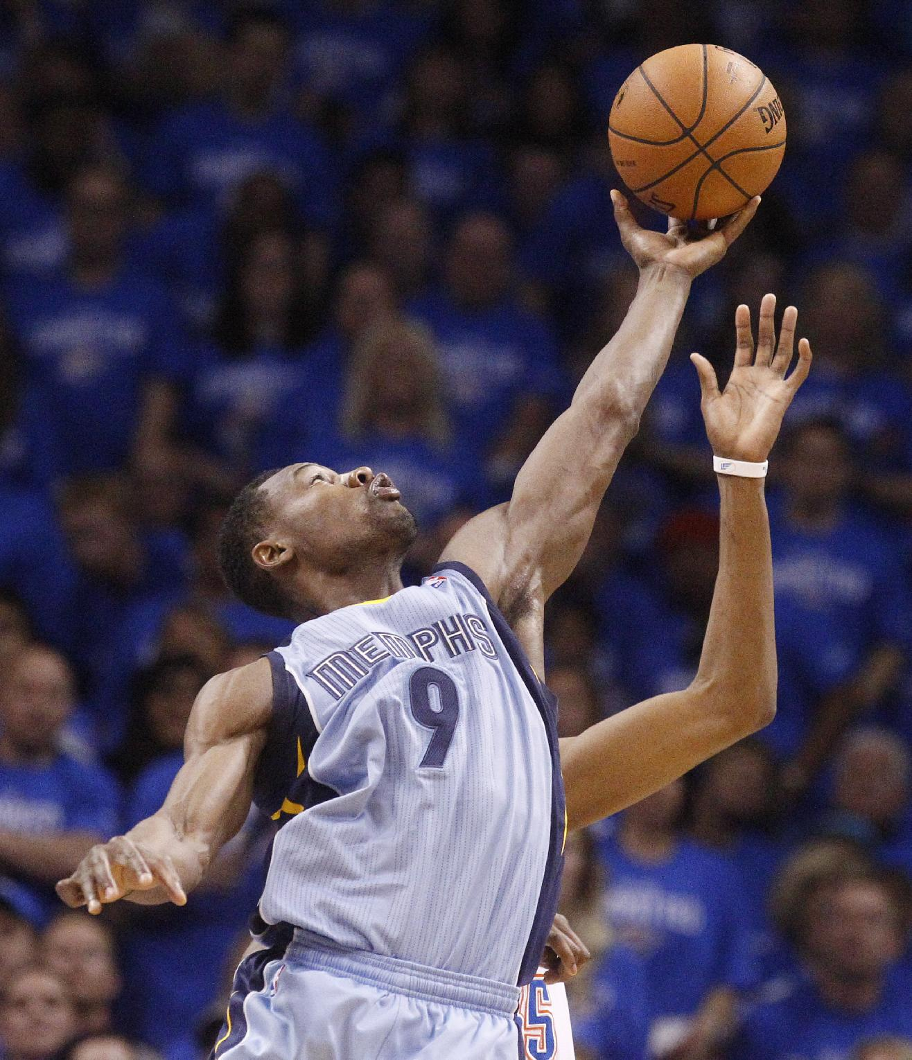 Memphis Grizzlies guard Tony Allen (9) jumps up to grab a pass intended for Oklahoma City Thunder forward Kevin Durant, rear, in the first quarter of Game 2 of an opening-round NBA basketball playoff series in Oklahoma City, Monday, April 21, 2014