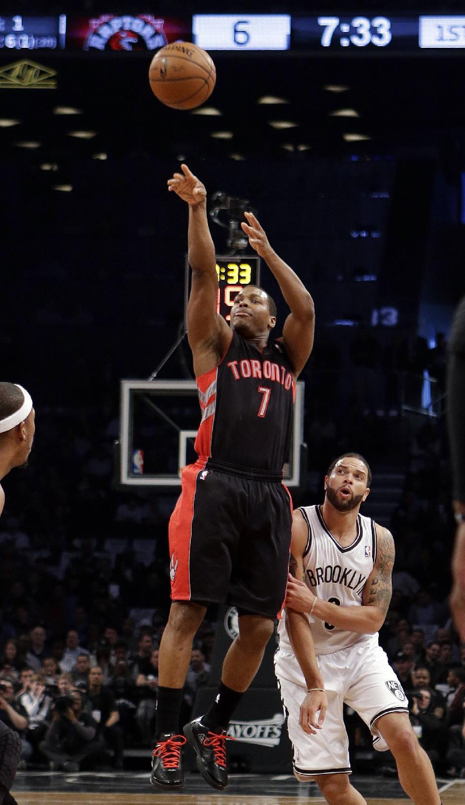 Toronto Raptors' Kyle Lowry (7) shoots over Brooklyn Nets' Deron Williams during the first half of Game 3 of an NBA basketball first-round playoff series Friday, April 25, 2014, in New York