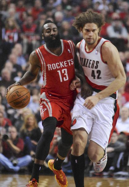 Houston Rockets' James Harden (13) drives against Portland Trail Blazers' Robin Lopez (42) during the first half of game four of an NBA basketball first-round playoff series game in Portland, Ore., Sunday March 30, 2014