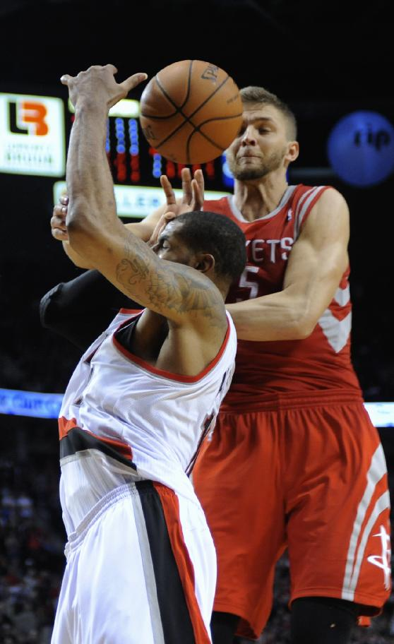 Portland Trail Blazers' LaMarcus Aldridge (12) is fouled by Houston Rockets' Chandler Parsons (25) during the overtime of game four of an NBA basketball first-round playoff series game in Portland, Ore., Sunday April 27, 2014. The Trail Blazers beat the Rockets 123-120 in overtime