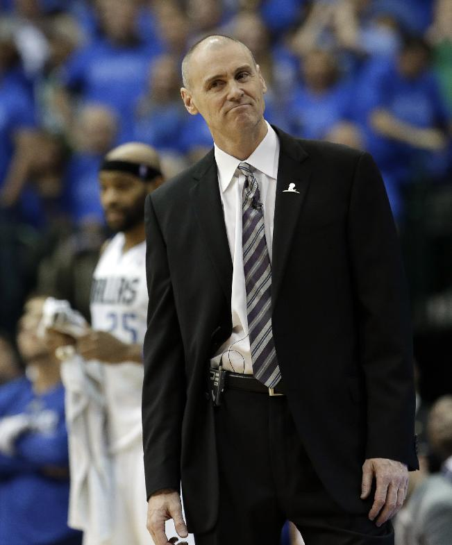 Dallas Mavericks coach Rick Carlisle watches from the sideline after his team was charged with a foul late in the second half of Game 4 of an NBA basketball first-round playoff series against the San Antonio Spurs, Monday, April 28, 2014, in Dallas. The Spurs won 93-89