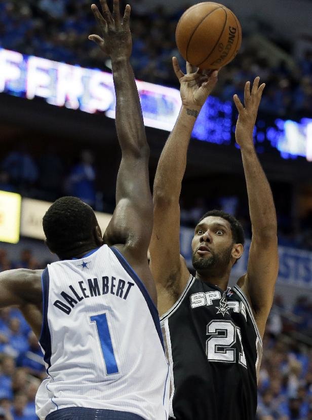 Dallas Mavericks' Samuel Dalembert (1), of Haiti, defends as San Antonio Spurs' Tim Duncan shoots during the second half of Game 4 of an NBA basketball first-round playoff series, Monday, April 28, 2014, in Dallas. The Spurs won 93-89