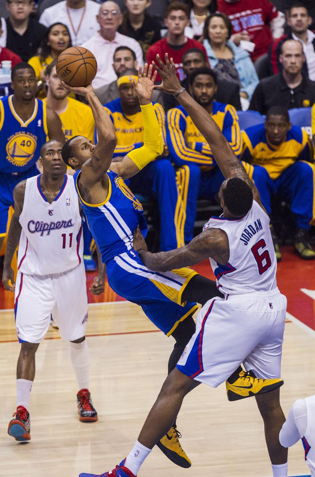 Golden State Warriors forward Andre Iguodala (9) shoots against Los Angeles Clippers center DeAndre Jordan (6) during the first half of Game 7 of a first-round NBA basketball playoff series, Saturday, May 3, 2014, in Los Angeles