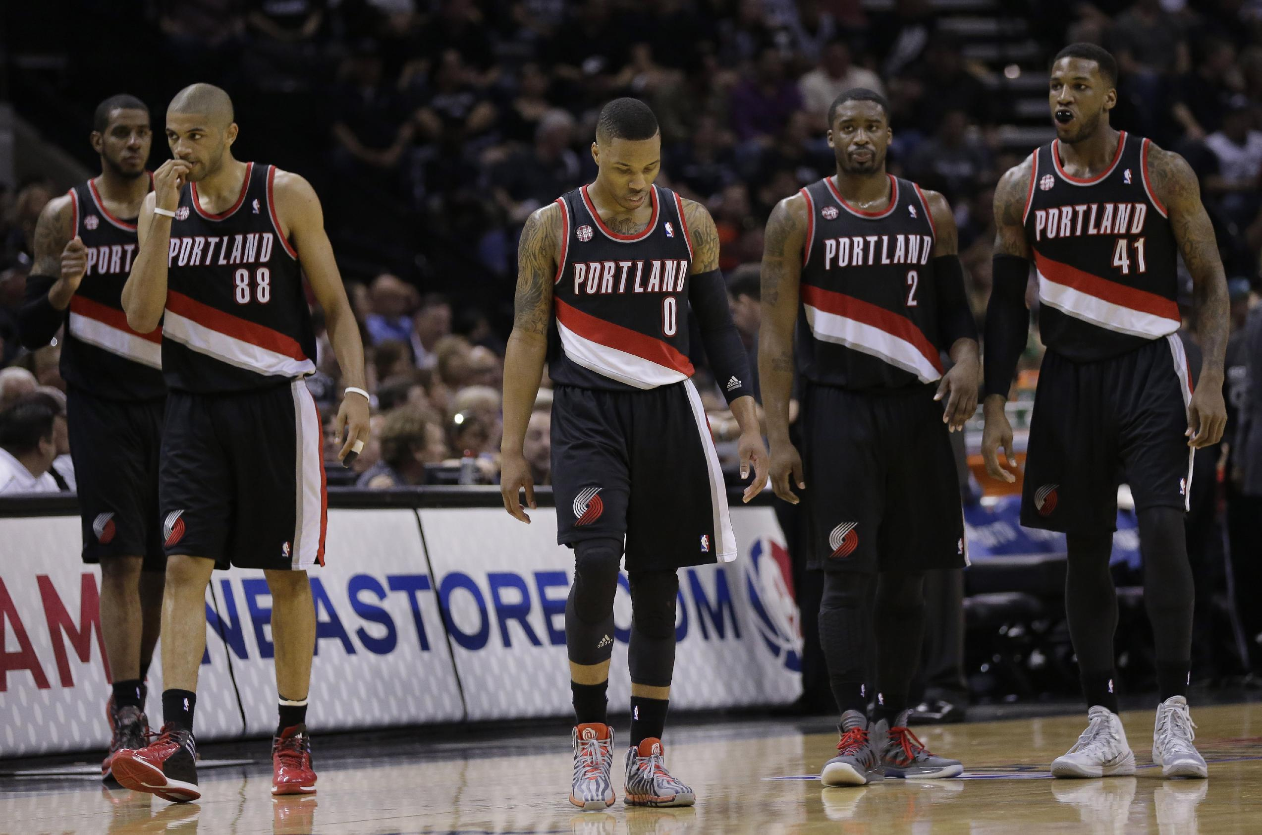 Portland Trail Blazers' LaMarcus Aldridge, left, Nicolas Batum (88), Damian Lillard (0), Wesley Matthews (2), and Thomas Robinson (41) walk on to the court following a time out during the first half of Game 2 of a Western Conference semifinal NBA basketball playoff series against the San Antonio Spurs, Thursday, May 8, 2014, in San Antonio