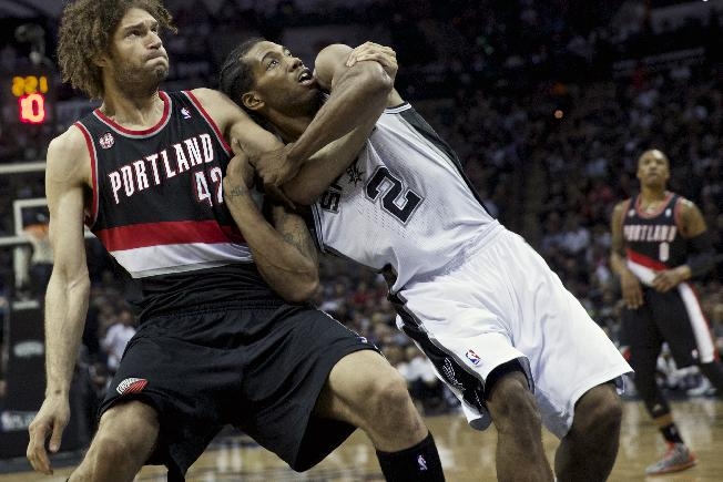 Portland Trail Blazers center Robin Lopez (42) battles San Antonio Spurs forward Kawhi Leonard (2) during Game 2 of a Western Conference semifinal NBA basketball playoff series, Thursday, May 8, 2014, in San Antonio. San Antonio won 114-97
