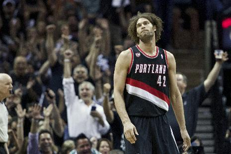 Portland Trail Blazers' Robin Lopez (42) looks on during Game 2 of a Western Conference semifinal NBA basketball playoff series against the San Antonio Spurs, Thursday, May 8, 2014, in San Antonio. San Antonio won 114-97