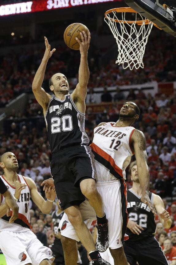 San Antonio Spurs' Manu Ginobili (20) lays the ball up as Portland Trail Blazers' LaMarcus Aldridge (12) defends in the third quarter during Game 3 of a Western Conference semifinal NBA basketball playoff series Saturday, May 10, 2014, in Portland, Ore. The Spurs won 118-103
