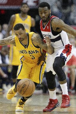 Indiana Pacers guard George Hill (3) and Washington Wizards guard John Wall (2) chase a loose ball during the first half of Game 4 of an Eastern Conference semifinal NBA basketball playoff game in Washington, Sunday, May 11, 2014