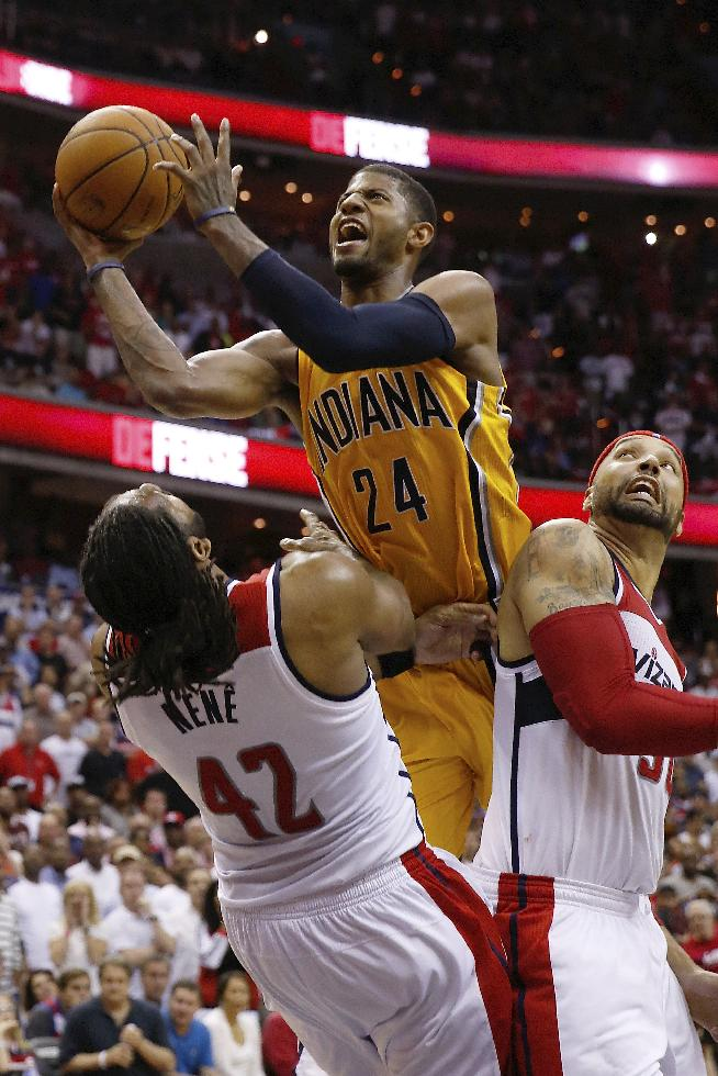 Indiana Pacers forward Paul George (24) shoots between Washington Wizards forward Nene from Brazil (42) and Washington Wizards forward Drew Gooden during the second half of Game 4 of an Eastern Conference semifinal NBA basketball playoff game in Washington, Sunday, May 11, 2014. The Pacers won 95-92