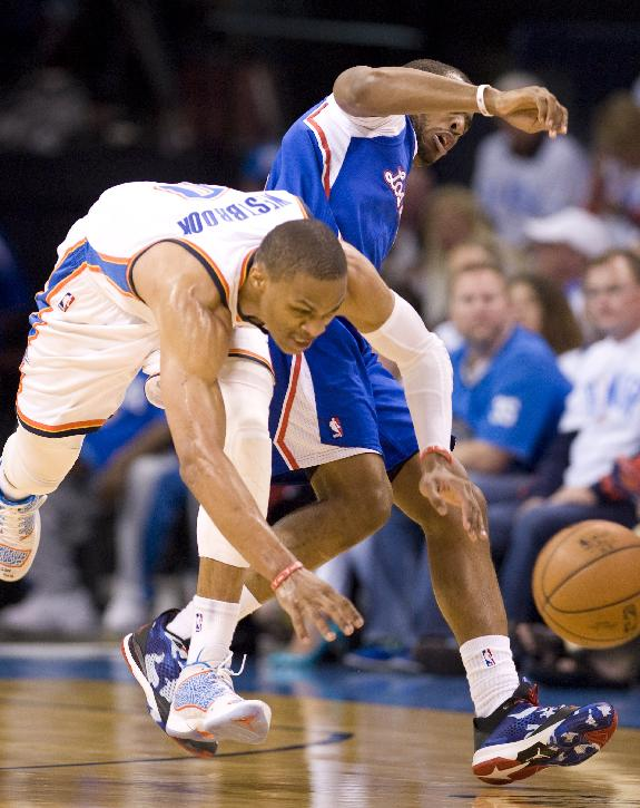 Oklahoma City Thunder's guard Russell Westbrook knocks the ball away from Los Angeles Clippers' guard Chris Paul during the second half in Game 5 of the NBA Western Conference semi-finals at the Chesapeake Arena in Oklahoma City on Tuesday, May 13, 2014