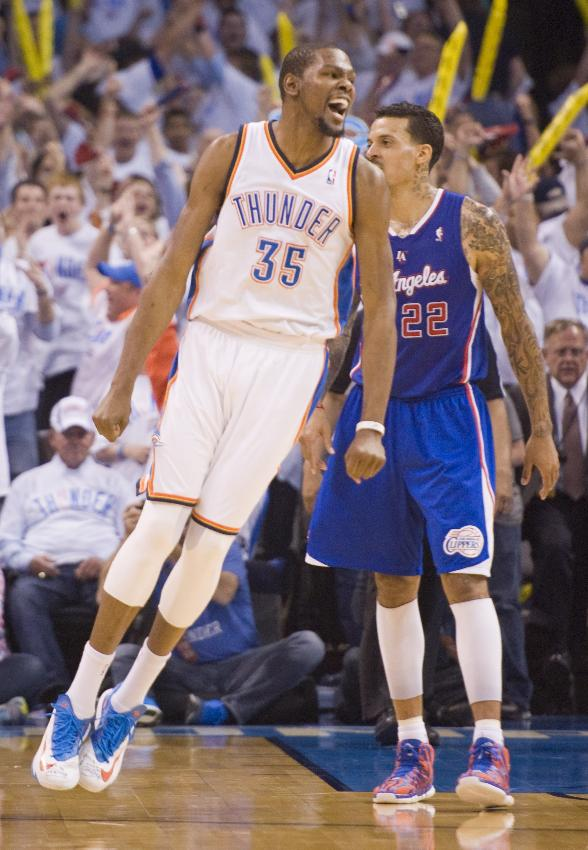 Oklahoma City Thunder's forward Kevin Durant  jubilates in front of Los Angeles Clippers' forward Matt Barnes at the end of Game 5 of the NBA Western Conference semi-finals at the Chesapeake Arena in Oklahoma City on Tuesday, May 13, 2014