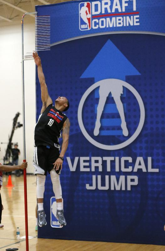 Shabazz Napier, from Connecticut, participates in the standing vertical jump at the 2014 NBA basketball draft combine Friday, May 16, 2014, in Chicago