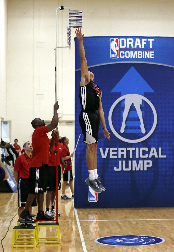 Aaron Gordon, from Arizon, makes his second attempt in running vertical jump at the 2014 NBA basketball draft combine Friday, May 16, 2014, in Chicago.  Gordon topped out at 12 feet and the measuring pole was raised on stools for a higher reading