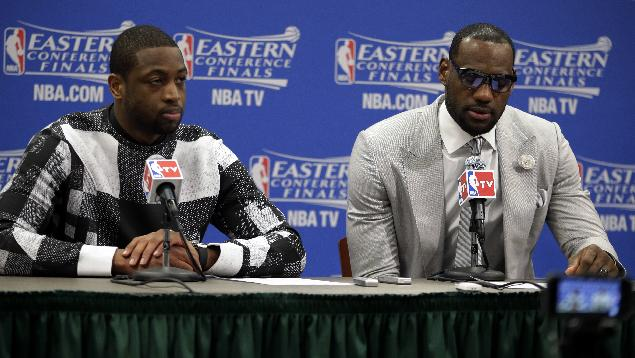 Miami Heat guard Dwyane Wade and forward LeBron James, right, talk with the media after Game 1 of the Eastern Conference finals NBA basketball playoff series against the Indiana Pacers, Sunday, May 18, 2014, in Indianapolis. The Pacers won 107-96. Wade scored 27 points and James had 25 for the two-time defending NBA champions, who lost for only the second time in 10 playoff games