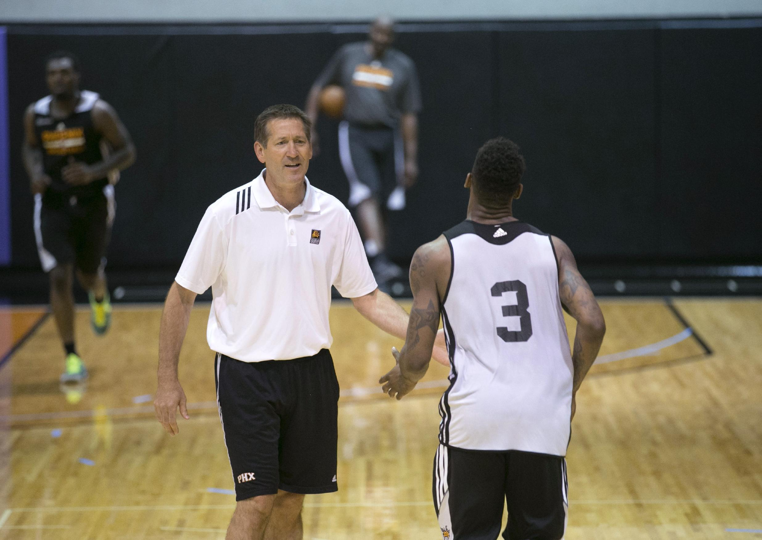 NBA basketball draft prospect DeAndre Kane from Iowa State slaps five with Phoenix Suns coach Jeff Hornacek while running during a workout for prospective draftees in Phoenix on Thursday, May 29, 2014. ( AP Photo/The Arizona Republic, David Wallace)