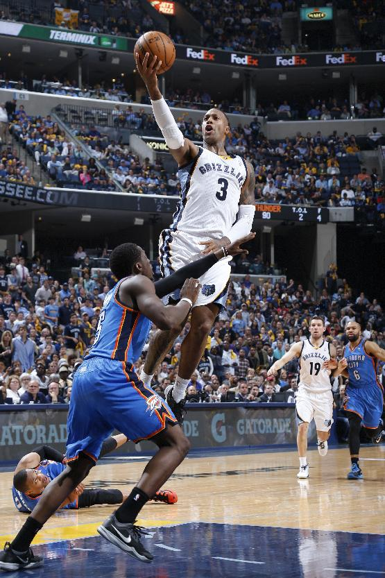 MEMPHIS, TN - MAY 1: James Johnson #3 of the Memphis Grizzlies drives to the basket against the Oklahoma City Thunder during Game Six of the Western Conference Quarterfinals of the 2014 NBA Playoffs on May 1, 2014 at FedEx Forum in Memphis, Tennessee. The Thunder won 104-84. NOTE TO USER: User expressly acknowledges and agrees that, by downloading and or using this photograph, User is consenting to the terms and conditions of the Getty Images License Agreement. (Photo by Joe Robbins/Getty Images)