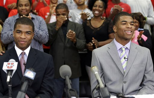 Twins Aaron, left, and Andrew Harrison announce they will play for Kentucky. (AP)